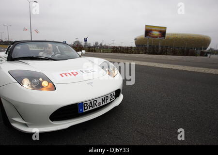Gdansk, Poland 23th, November 2013 Re:City recycling and ecological fair. Tesla electric sports car presentation. - Stock Photo