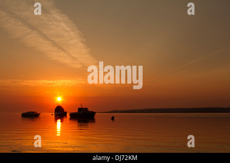 Sunset over the Penclawdd estuary - Stock Photo