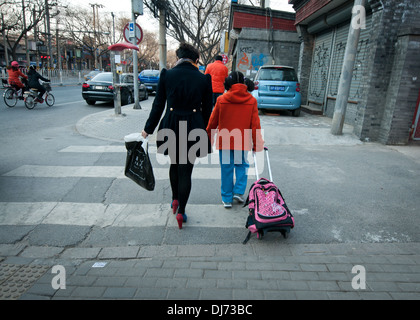 Mother and her daughter walking on a street in Shanghai, China - Stock Photo