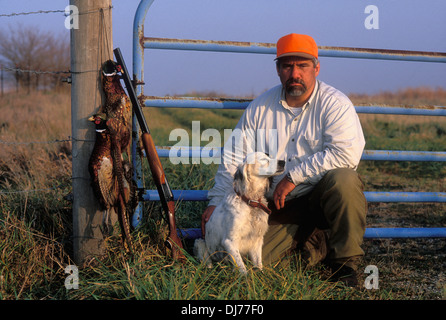 Upland Bird Hunter with Pheasants after Successful Bird Hunt in Northern Indiana - Stock Photo