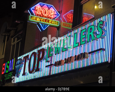 Top Indian Jewelers Rusholme Curry Mile Manchester England UK at night - Stock Photo