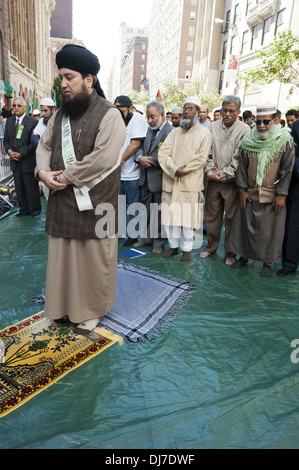 Annual Muslim Day Parade, New York City, 2012. Men praying on Madison Ave. before start of the parade. - Stock Photo