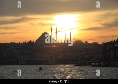 Bosphorus Golden Horn in Istanbul with Sunset and Mosque - Stock Photo