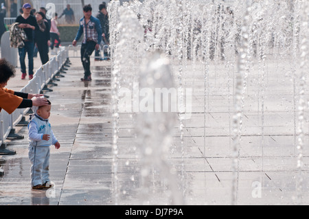 fountains in front of Beijing National Aquatics Center commonly known as Water Cube - Stock Photo