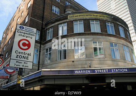 Warren Street Station from outside with Congestion Charging or charge Central Zone sign adjacent, London England - Stock Photo