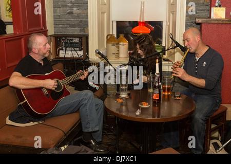 Irish folk singing in McGann's bar, Doolin, Co. Clare, Ireland - Stock Photo