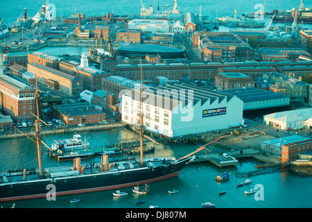 HMS Warrior, HMS Victory and the Mary Rose museum in aerial view across the historical Portsmouth dockyard - Stock Photo