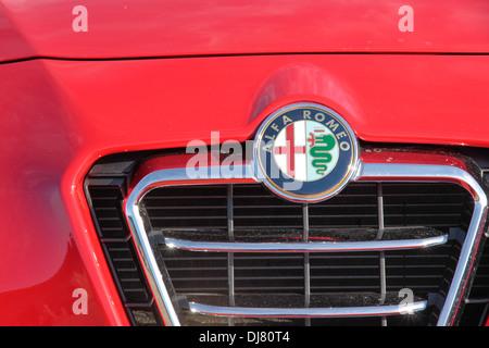 Alfa Romeo logo on red sports car - Stock Photo