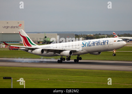 SriLankan Airlines Airbus A340, the National Airline of Sri Lanka landing at London Heathrow Airport - Stock Photo