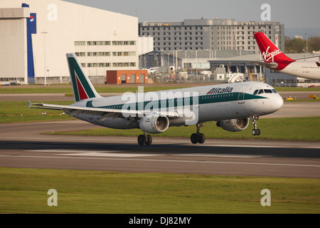 Alitalia airbus a320 landing at London Heathrow Airport - Stock Photo