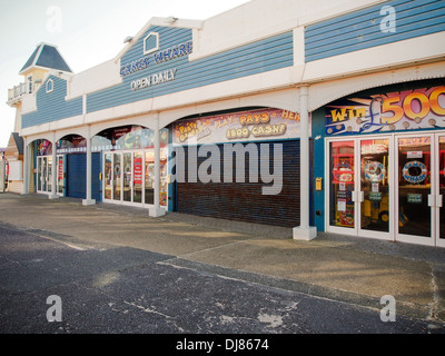 Closed down amusements and Arcades on Clarence Pier fairground in Southsea, Portsmouth during the winter months - Stock Photo