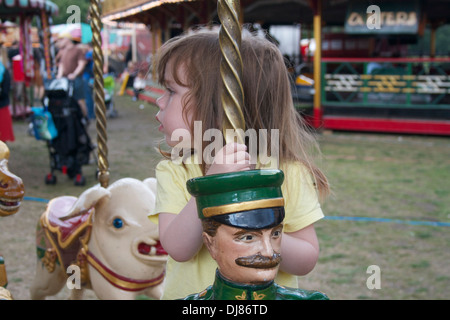 A young girl on a fairground ride - Stock Photo