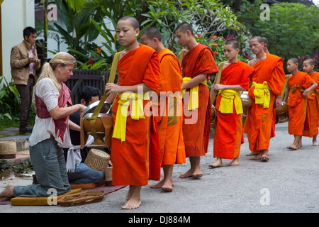 Alms giving ceremony in Luang Prabang, Laos - Stock Photo
