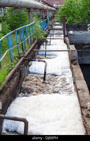 Toxic sewage water discharged into the canal - Stock Photo