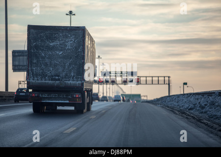Truck on dirty winter ring road in the evening. St. Petersburg, Russia - Stock Photo