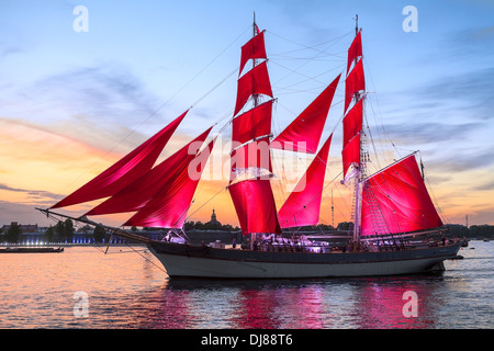 Celebration Scarlet Sails show during the White Nights Festival, St. Petersburg, Russia. Vessel over sunset sky - Stock Photo