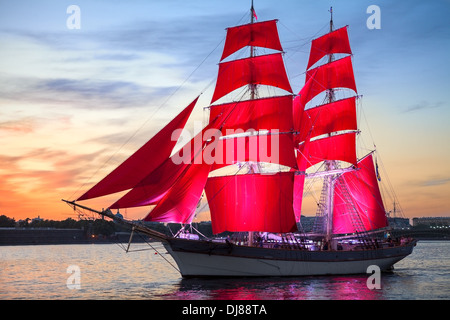 Celebration Scarlet Sails show during the White Nights Festival, St. Petersburg, Russia. Ship over sunset sky - Stock Photo