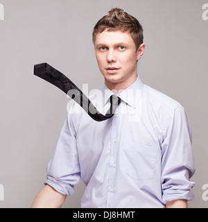 dynamic shot of guy with flying tie - Stock Photo