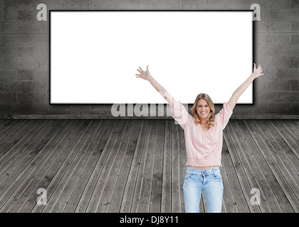 Smiling woman with her arms raised up - Stock Photo