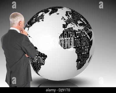 Composite image of thoughtful businessman standing back to camera - Stock Photo