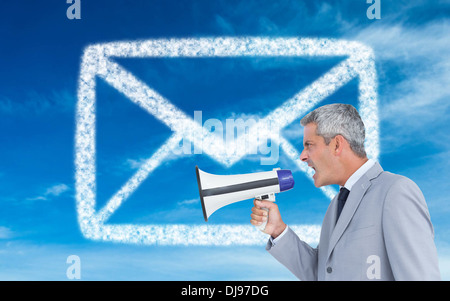 Composite image of businessman shouting in loudspeaker - Stock Photo