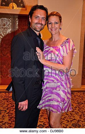 sophie schuett and boyfriend felix seitz and gerit kling at bmw golf stock photo royalty free. Black Bedroom Furniture Sets. Home Design Ideas