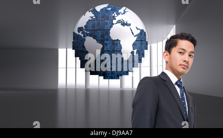 Composite image of digital globe on grey abstract background - Stock Photo