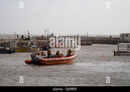 RNLI Lifeboat in harbour preparing to go out to sea as storm approaches - Stock Photo