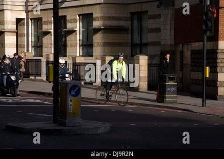 Cyclist at traffic light, London - Stock Photo