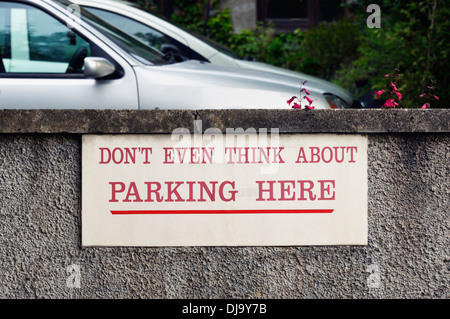 'DON'T EVEN THINK ABOUT PARKING HERE' sign. Captain French Lane, Kendal, Cumbria, England, United Kingdom, Europe. - Stock Photo