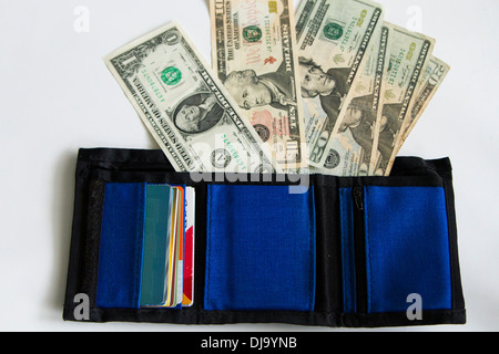US dollar money and cards in a blue wallet on white background. - Stock Photo