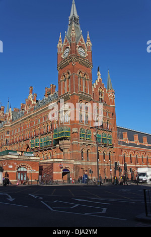 A side view of Saint Pancras railway station in London showing the large clock tower and old Hotel rooms along the - Stock Photo