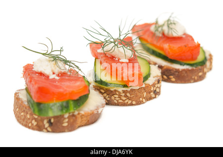 canapes with red fish on white background - Stock Photo