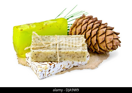 Cedar cone, three homemade soap on paper isolated on white background - Stock Photo