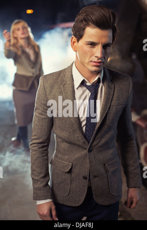 Handsome guy leaving his wife on the platform - Stock Photo