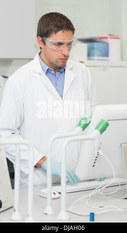 Male researcher using computer in lab - Stock Photo