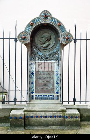 Commemorative plaque at the Church of Saint-Jean-de-Montmartre. - Stock Photo