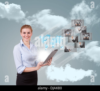Portrait of businesswoman holding her tablet computer and communicating with her team across the world.  - Stock Photo