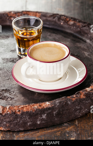 Coffee laced with brandy on dark background - Stock Photo