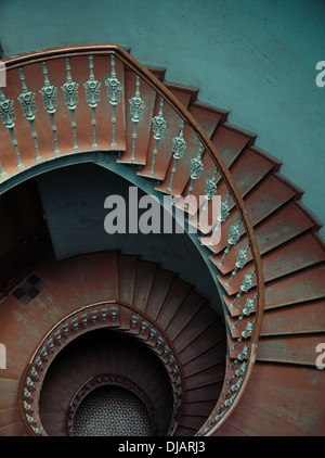 Interior of the palace with the wooden spiral stairs - Stock Photo