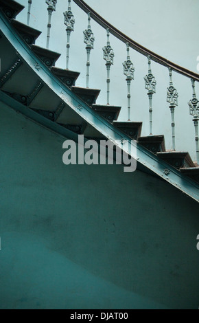 Wooden spiral stairs in ancient palace interior - Stock Photo