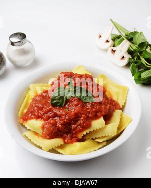 plate of Ravioli with marinara sauce - Stock Photo
