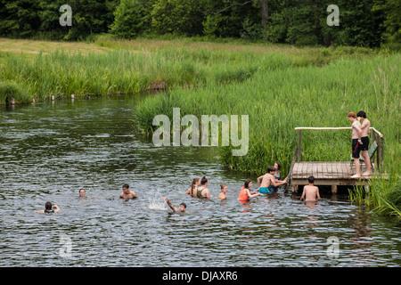Young people bathing in the Krutynia River, Ukta, Warmian-Masurian Voivodeship, Poland - Stock Photo