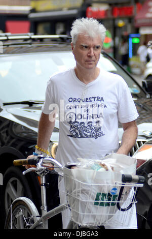 David Byrne Former Talking Heads frontman returns to his bicycle with groceries, after shopping at Whole Foods Market - Stock Photo