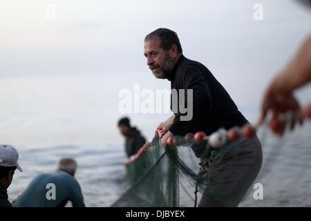 Nov. 26, 2013 - Gaza, Palestinian Territories - A Palestinian fisherman pulls the fishing net from the Gaza city - Stock Photo