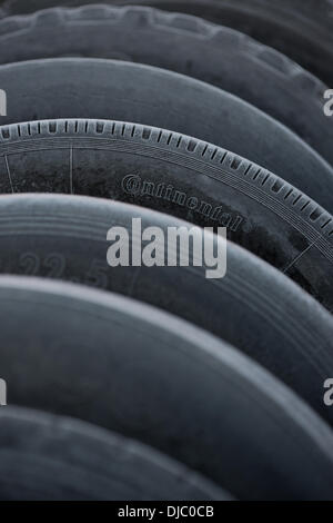 Hamburg, Germany. 25th Nov, 2013. Truck tires of different manufacturers covered with rime photographed after a - Stock Photo