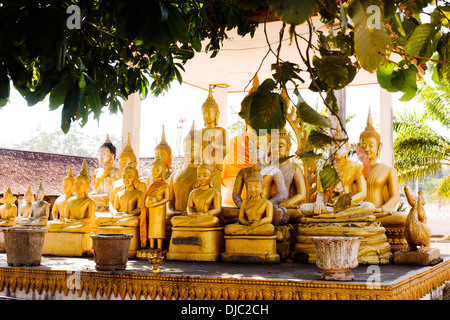 Golden Buddha statues in That In Hang Temple, Savannakhet, Laos. - Stock Photo