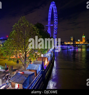 LONDON, UK - NOV 25TH 2013: A view of the Christmas Market on the South Bank in London on the 25th November 2013. - Stock Photo