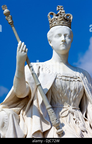 The impressive statue of Queen Victoria situated outside Kensington Palace in London. - Stock Photo