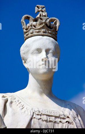 Statue of Queen Victoria situated outside Kensington Palace in London. - Stock Photo